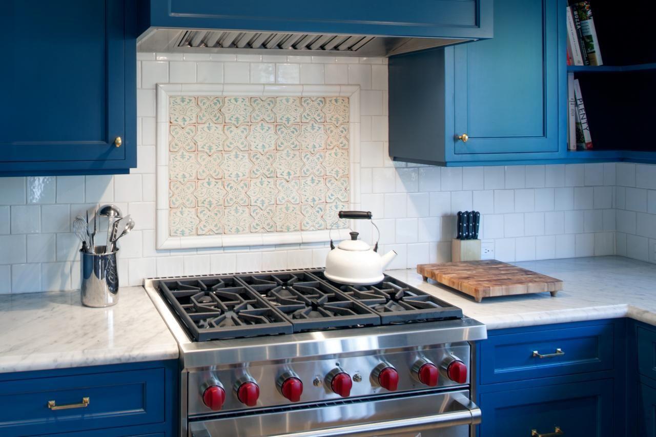 Hgtv adores this contemporary kitchen featuring white tile hgtv adores this contemporary kitchen featuring white tile backsplash blue cabinets carrera marble countertops dailygadgetfo Choice Image