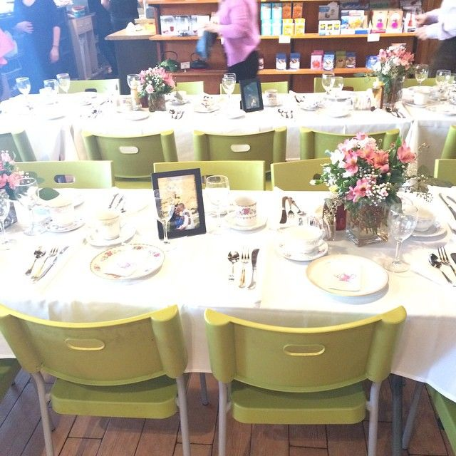 linens, flowers, mismatched china and engagement photos for bridal tea shower table decor
