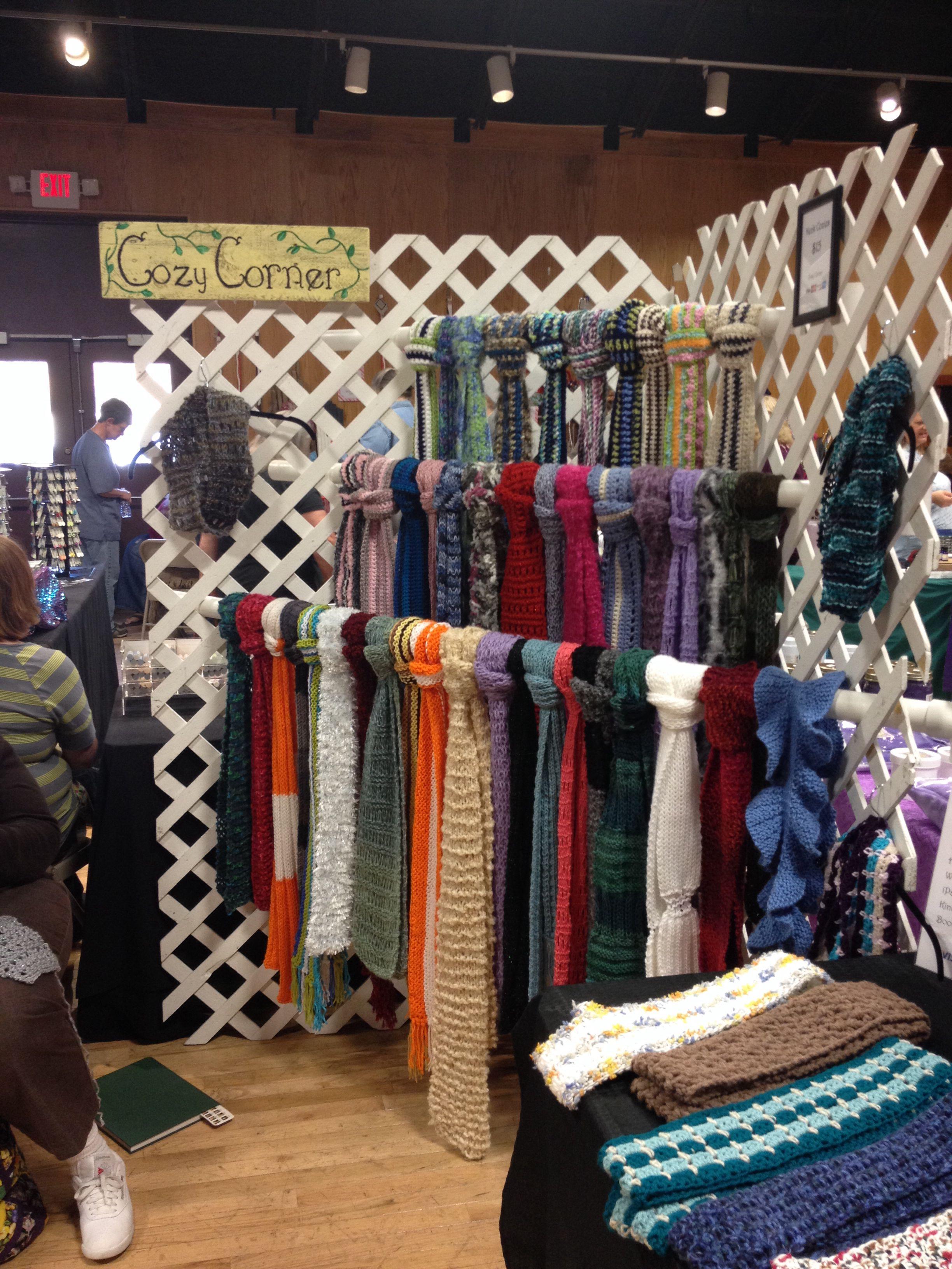 Craft booth scarf hangers are PVC pipes run thru lattice ...