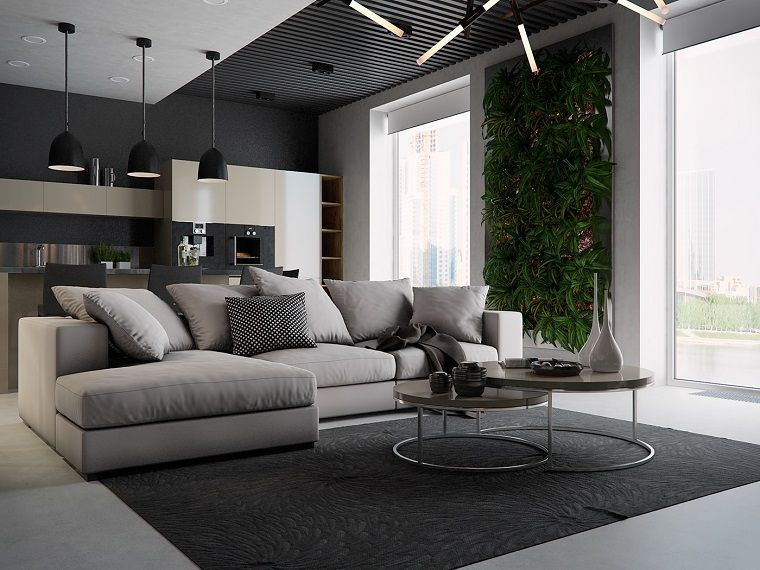 idee soggiorno con un divano angolare e giardino verticale
