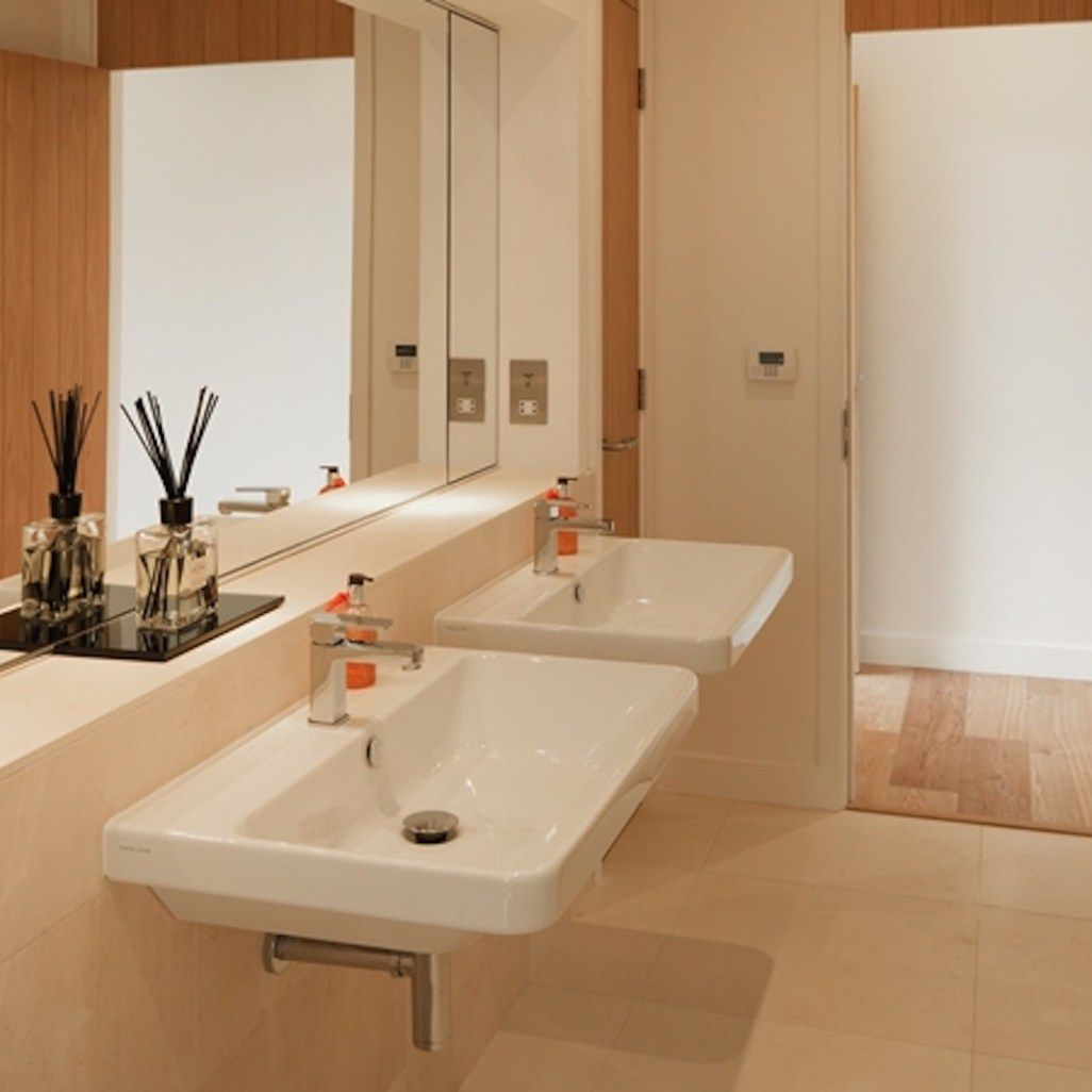 Bathroom design - Cheltenham by Sarah Ireland Designs featuring strong  statement pieces softened with neutral tiling