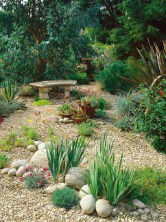 Use Gravel Pebbles And Bark Chips For Practical Versatile Garden Design Gravel Landscaping Gravel Garden Rock Garden Landscaping