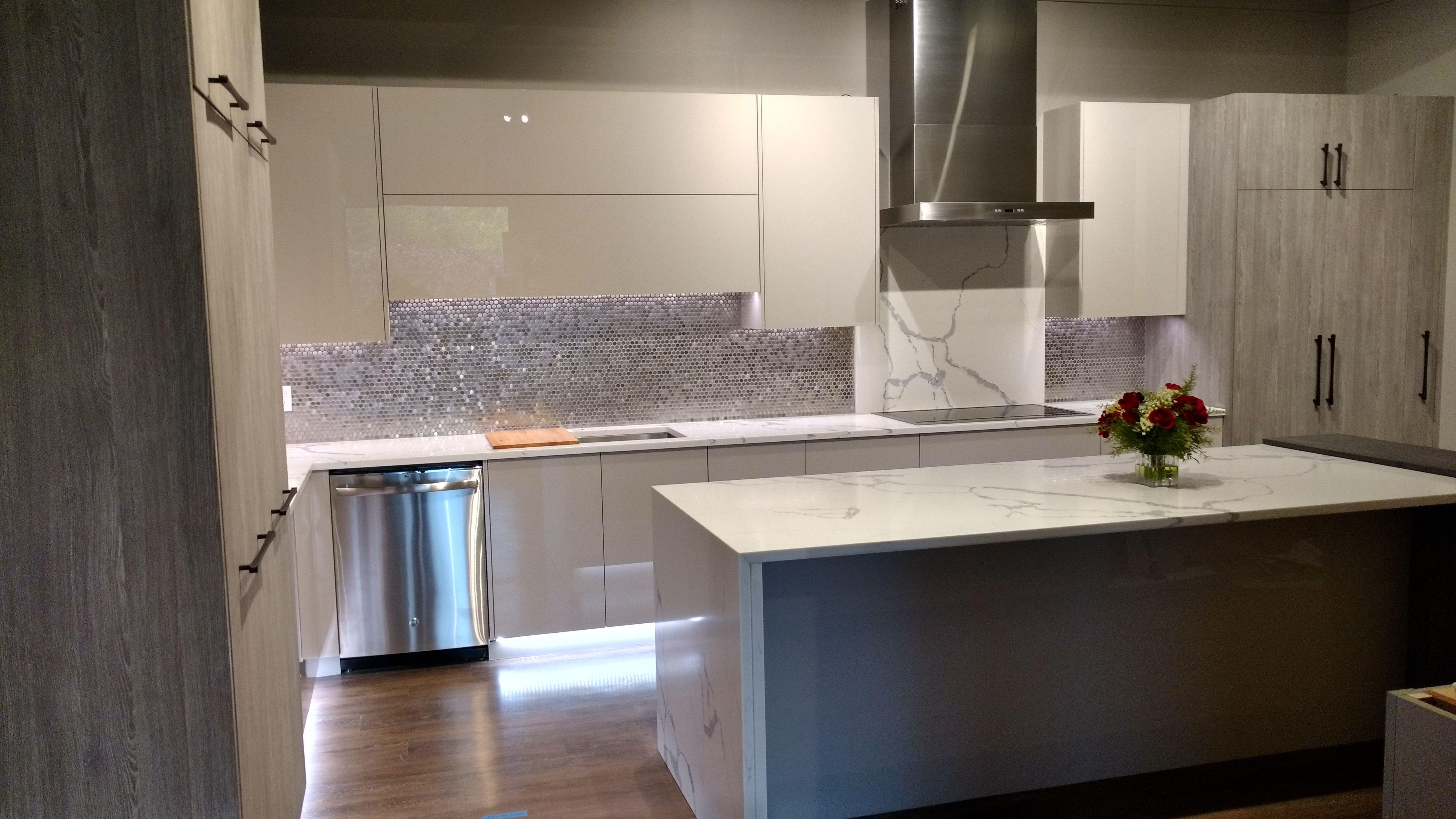 Modern Kitchen With Innovative Storage Solutions Our Showroom Kitchen Cabinets Kitchen Bath Showroom Custom Kitchen Cabinets