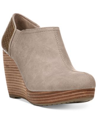 415f9b4c1547 The Harlow booties from Dr. Scholl s feature a stylish wedge that keeps you…