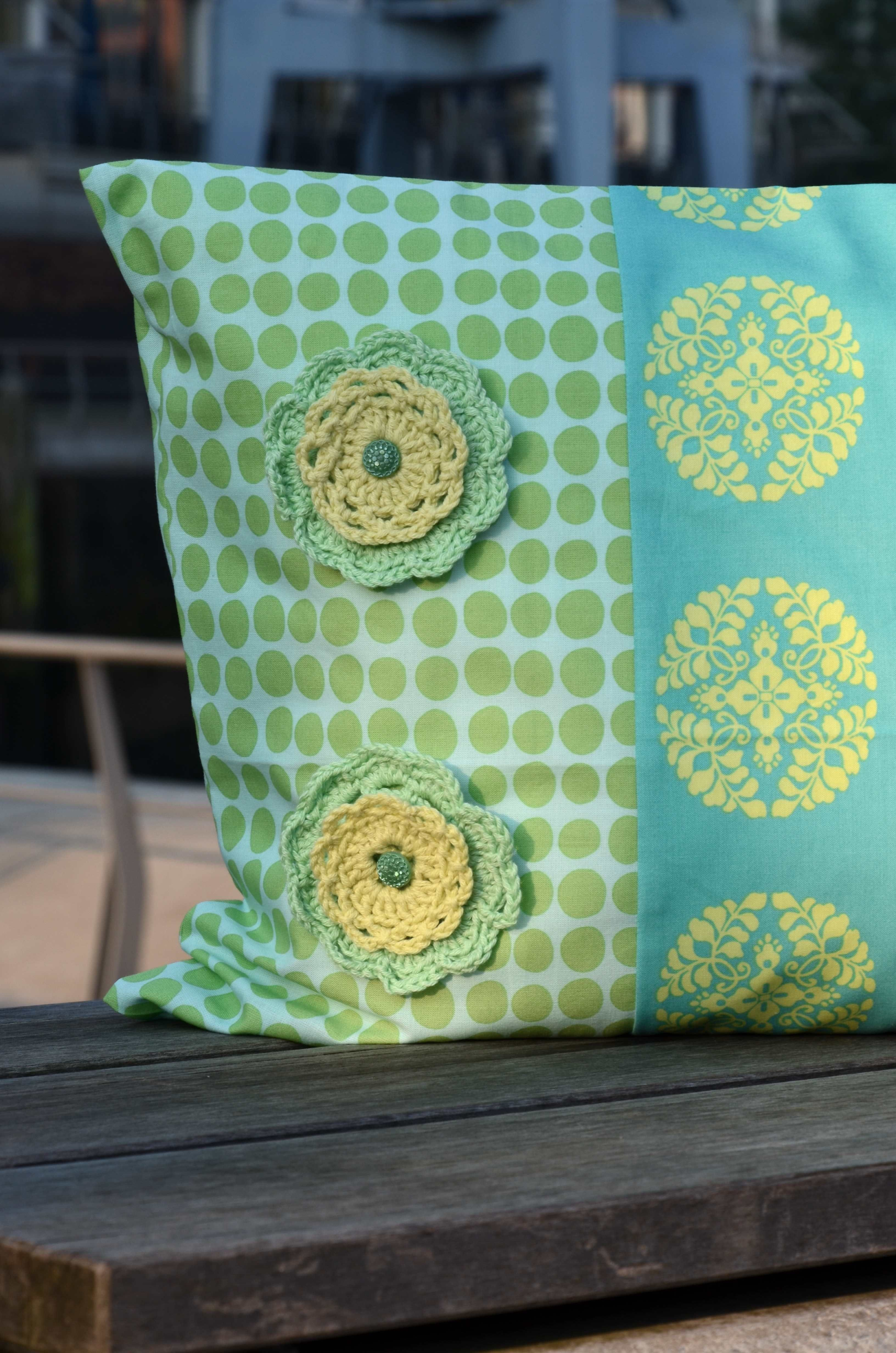 pillow case with crochet flowers, vintage button, with fabrics and wool from Amy Butler