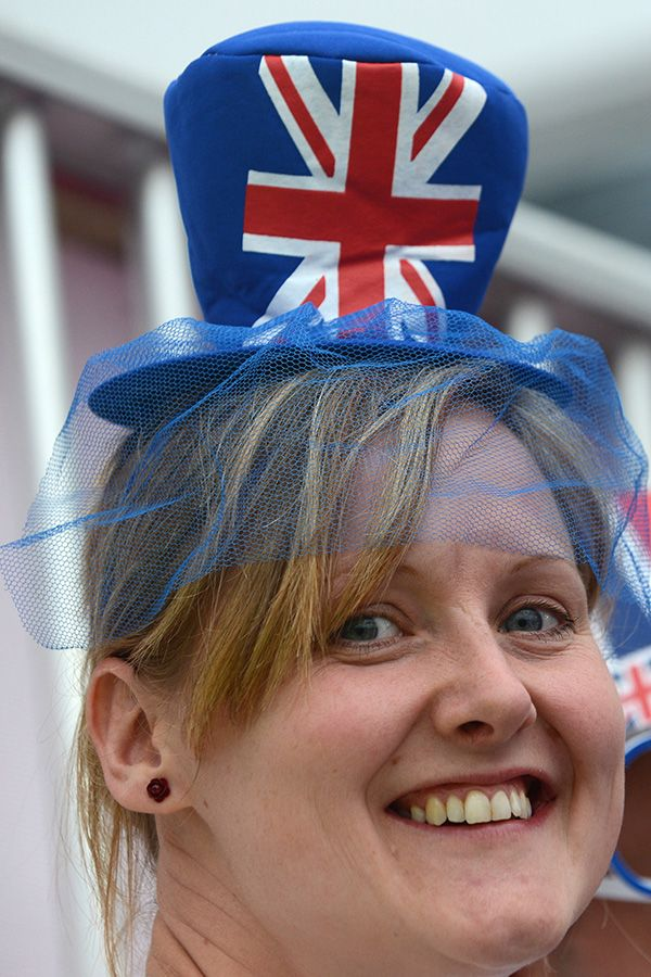 A spectator wears a hat depicting a Union Jack flag during the preliminary round women's field hockey match of the London 2012 Olympic Games between China and Belgium. (Photo by Indranil Mukherjee/AFP/Getty Images)
