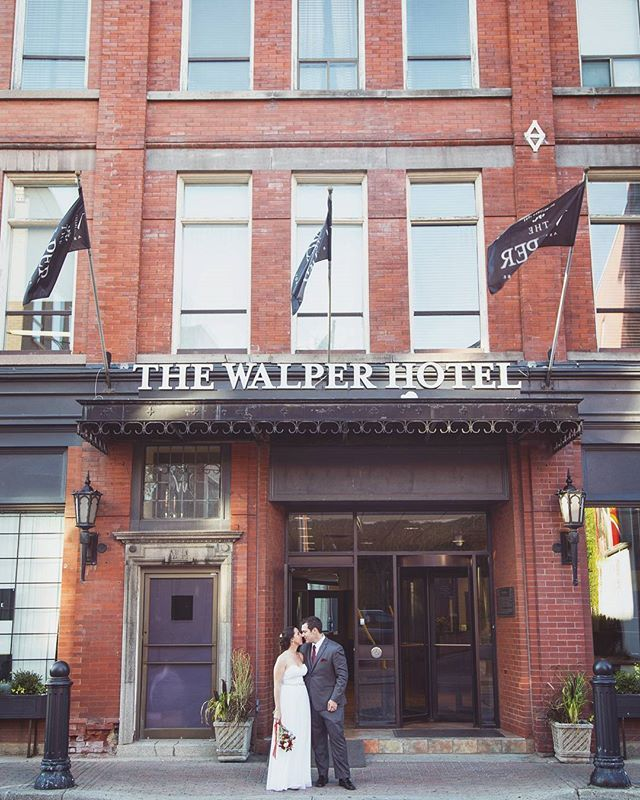 Newlyweds sneak a kiss at The Walper Hotel in Kitchener, Ontario ...