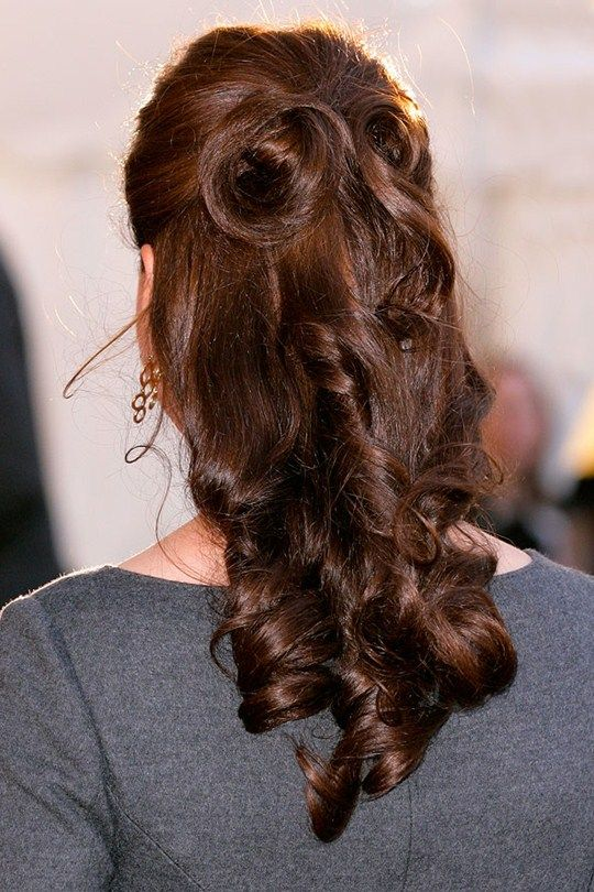 Kate stuns us with this directional half-up, half-down 'do during a reception at the Imperial War Museum, April 26, 2012. Ever the fashion maverick, Kate's brunette curls are whipped up in an ornate demi-chignon, complete with an on-trend quiff too. And from the back. Oh, how we love a good half-up, half-down 'do done Middleton style.