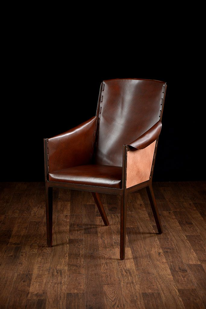 rustic leather arm chair with metal frame smooth interior leather over distressed metal frame exterior has