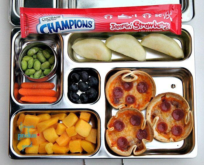 Mini Tortilla Pizzas, Yogurt Tube, Apple Slices, Mango, Blueberries, Freeze-dried edamame, Carrots Yumbox Bento.