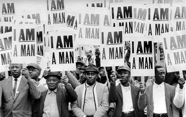 """The march led by Dr. Martin Luther King Jr. went forward March 28. Most of the 5,000-plus who participated were described as working-class, church-going people who donned their Sunday best because they believed in the righteousness of the strike and they believed in King. The """"I Am A Man"""" signs distributed that day came to symbolize the strike effort."""