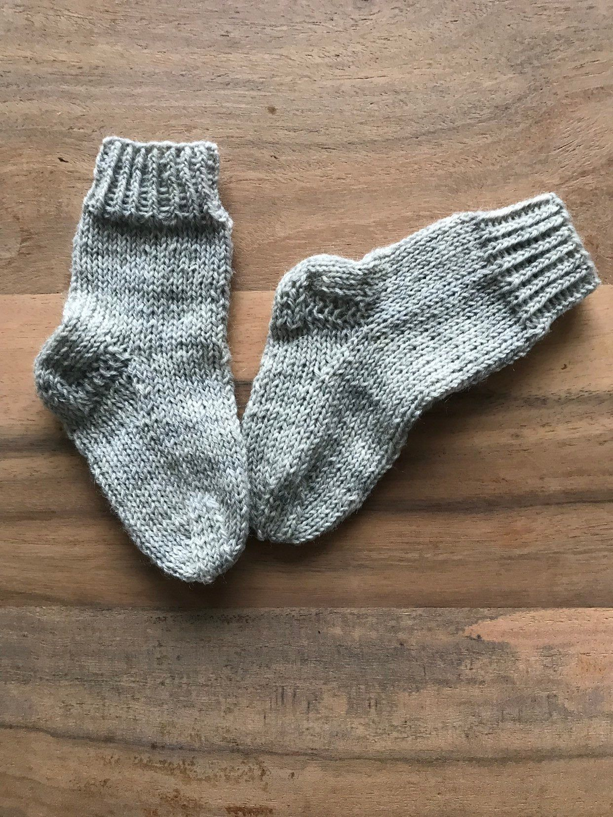 hand knitted baby socks  100/% pure wool   0-3 months