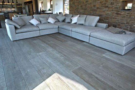 Grey Wood Floor Stain In Living Room With Grey Sofa Wooden