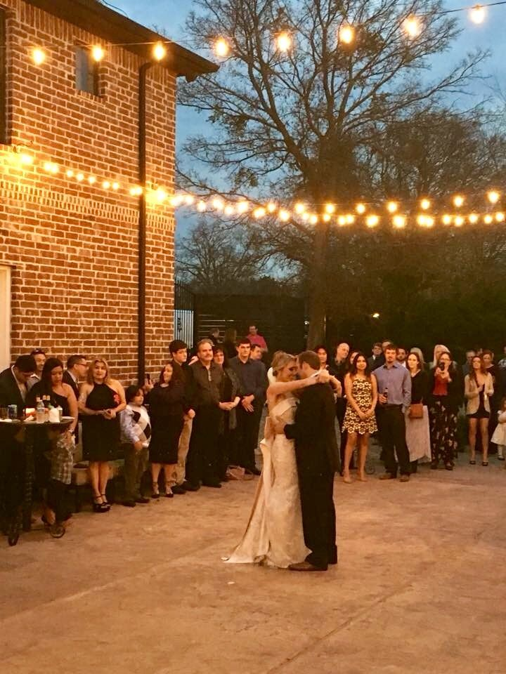 Dancing under the lights on the courtyard