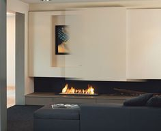 sliding door to open the television set above the fireplace