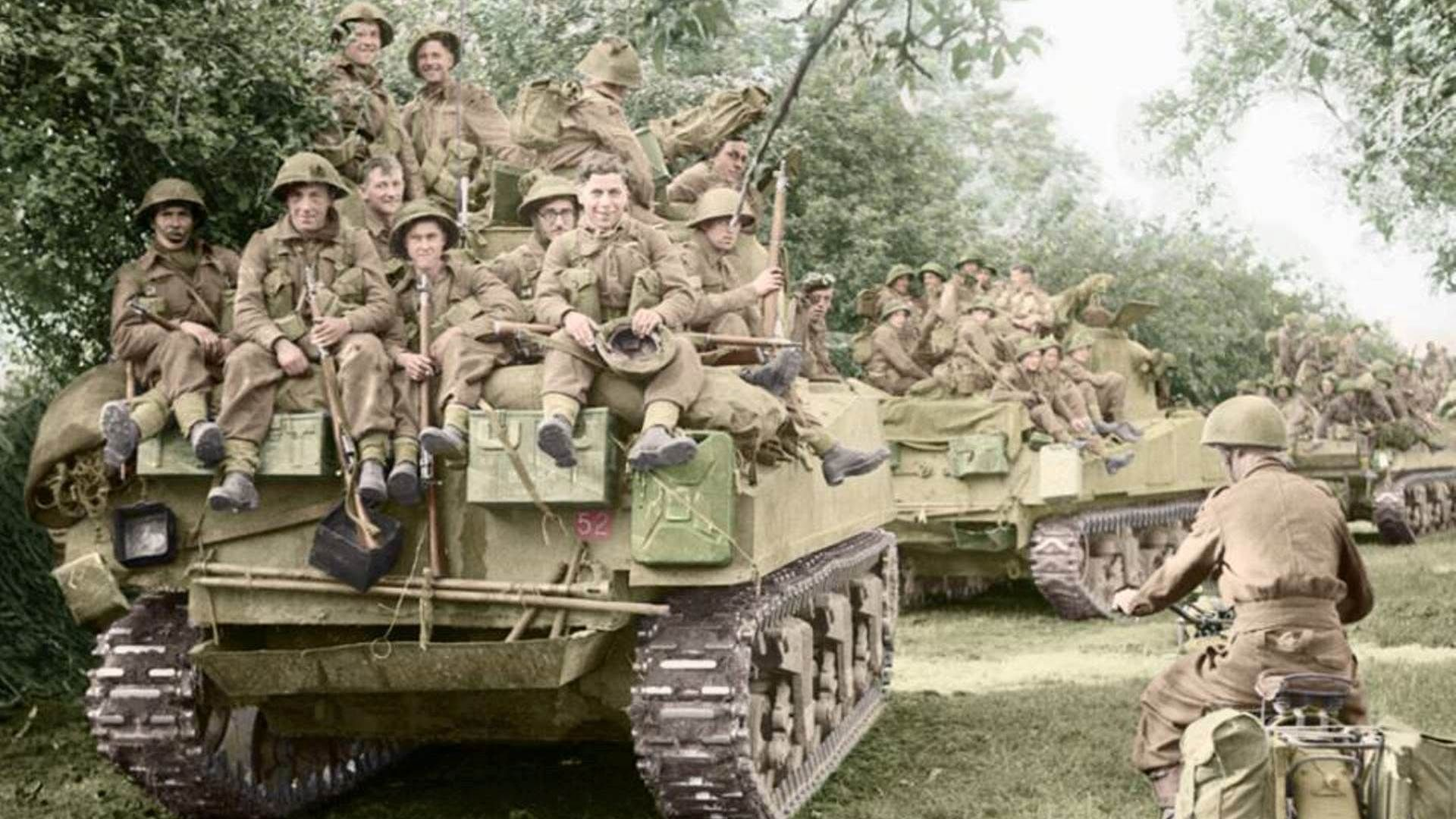 M4 Sherman Tanks Of The Staffordshire Yeomanry 27th Armoured Brigade Carrying Infantry From 3rd Division Move Up A Tanks Military Sherman Tank World War Two