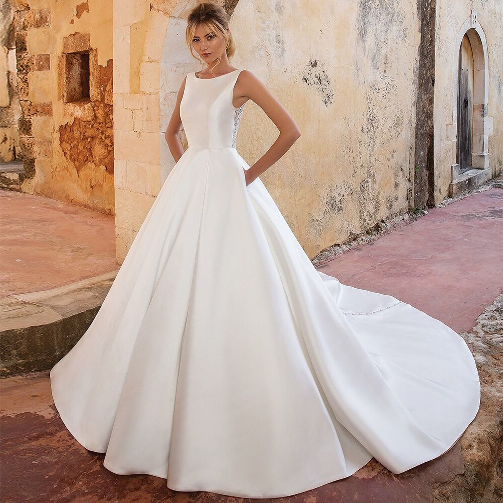 An Illusion Beaded Back Accents This Mikado Ball Gown With A Mixture Of Crystal A Justin Alexander Wedding Dress Princess Wedding Dresses Wedding Dresses Satin