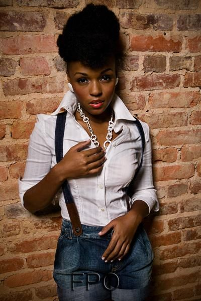 The fabulous naturalista songstress Janelle Monae in white blouse + suspenders + jeans