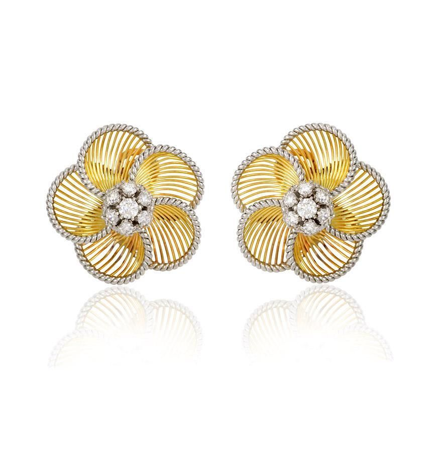 A pair of gold flower petal earrings of knife-wire design with a ...