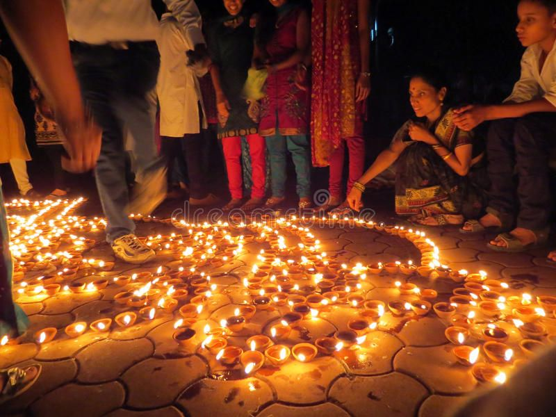 Diwali People People from India light up traditional earthen lamps on the occas
