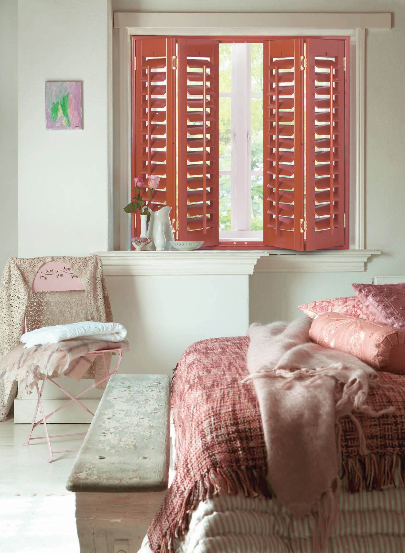Bright piano red wood shutters great a look for this bedroom window