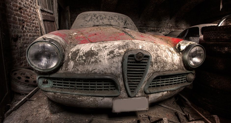 """Tim describes his pastime as """"urban exploration or the capture of unseen, derelict places and documenting decay that many people would not have the chance to see"""". Here he explains the story behind his discovery last November: """"One of the places that was definitely on my list to visit in Belgium was the 'Lost Alfas' – six Alfa Romeo 1960s sport cars left to rot in the bowels of an abandoned castle somewhere in Belgium."""""""