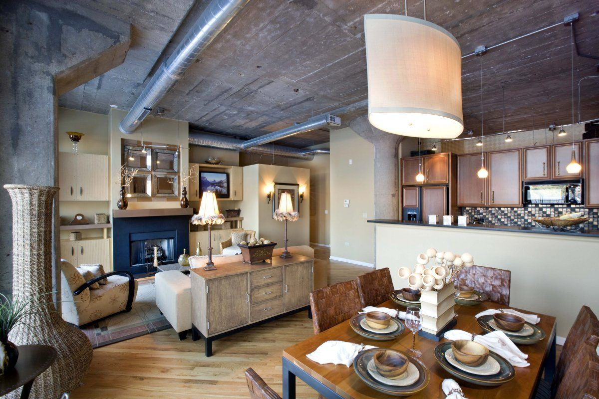 Vintage style chicago loft condo with concrete ceiling for Condo ceiling design