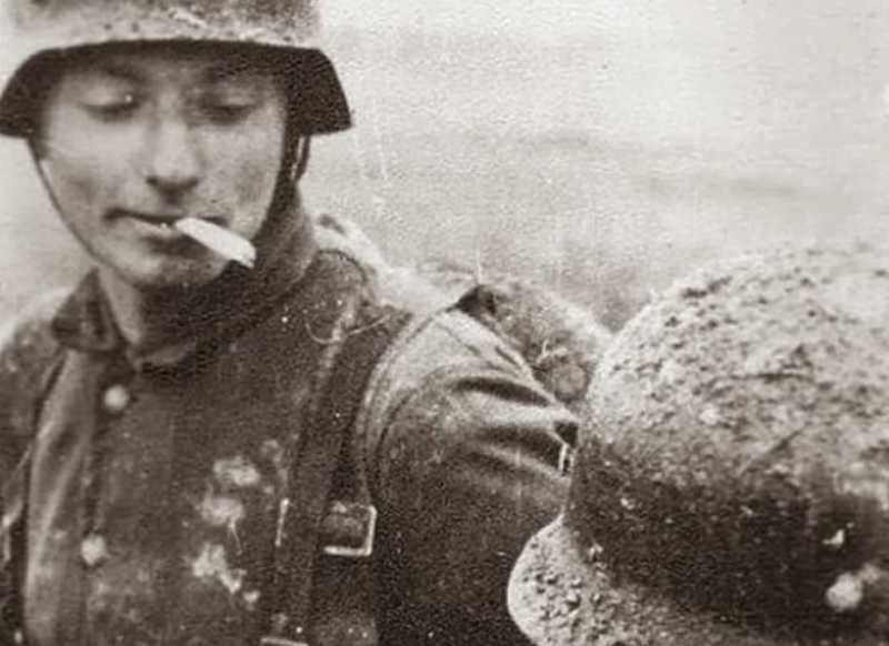 German soldier lighting his cigarette with a flamethrower 1940s.  sc 1 st  Pinterest & German soldier lighting his cigarette with a flamethrower 1940s ... azcodes.com