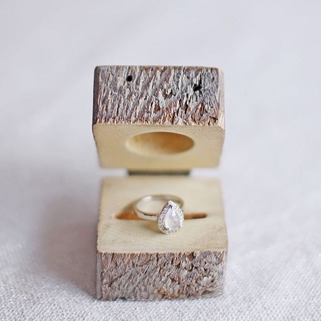 "Alyssa & Anna's ""Paloma"" ring in a weathered wood ring box"