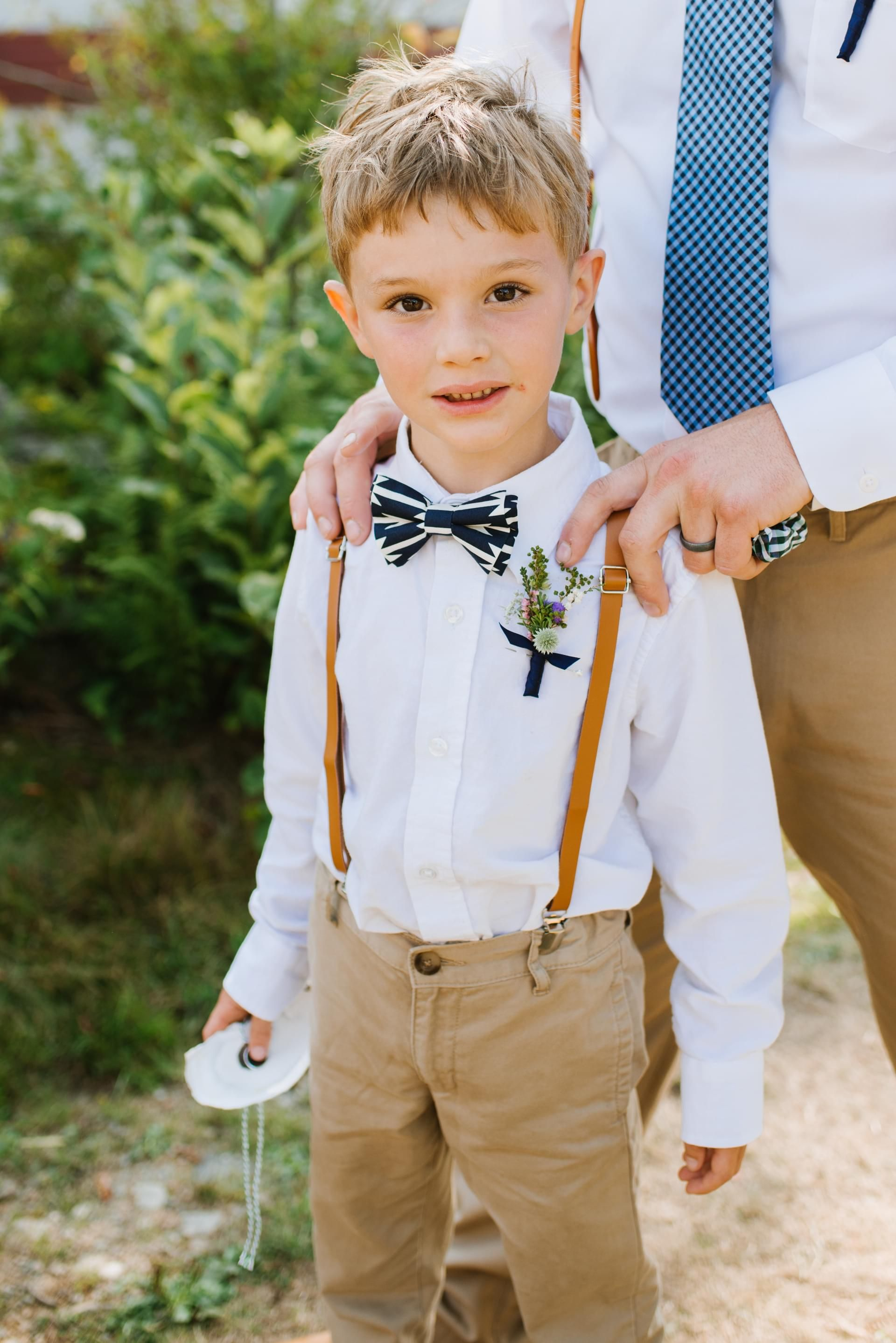 cb45cb497e3 Ring bearers in skinny cut pants suspenders and gold sequin bow