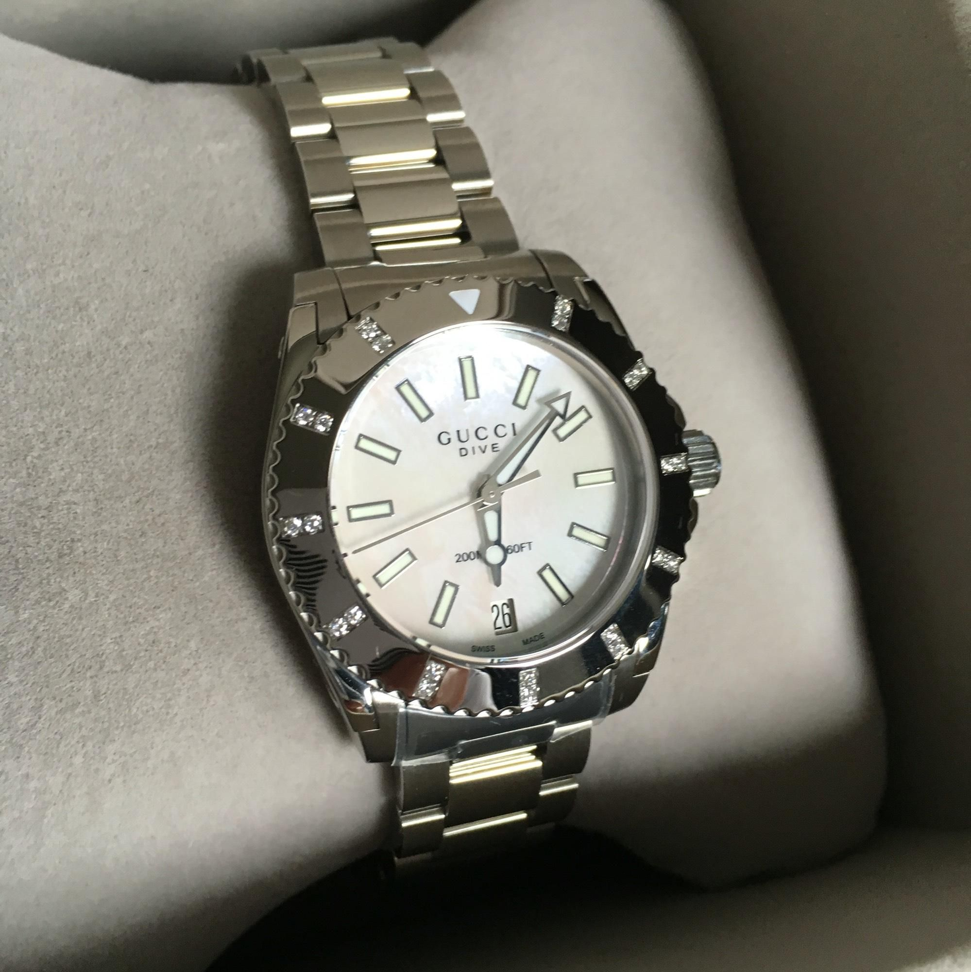 4ecf0860182 Free shipping and guaranteed authenticity on Gucci Women s Diamond Bezel  White Mother of Pearl Dive Watch at Tradesy. From the