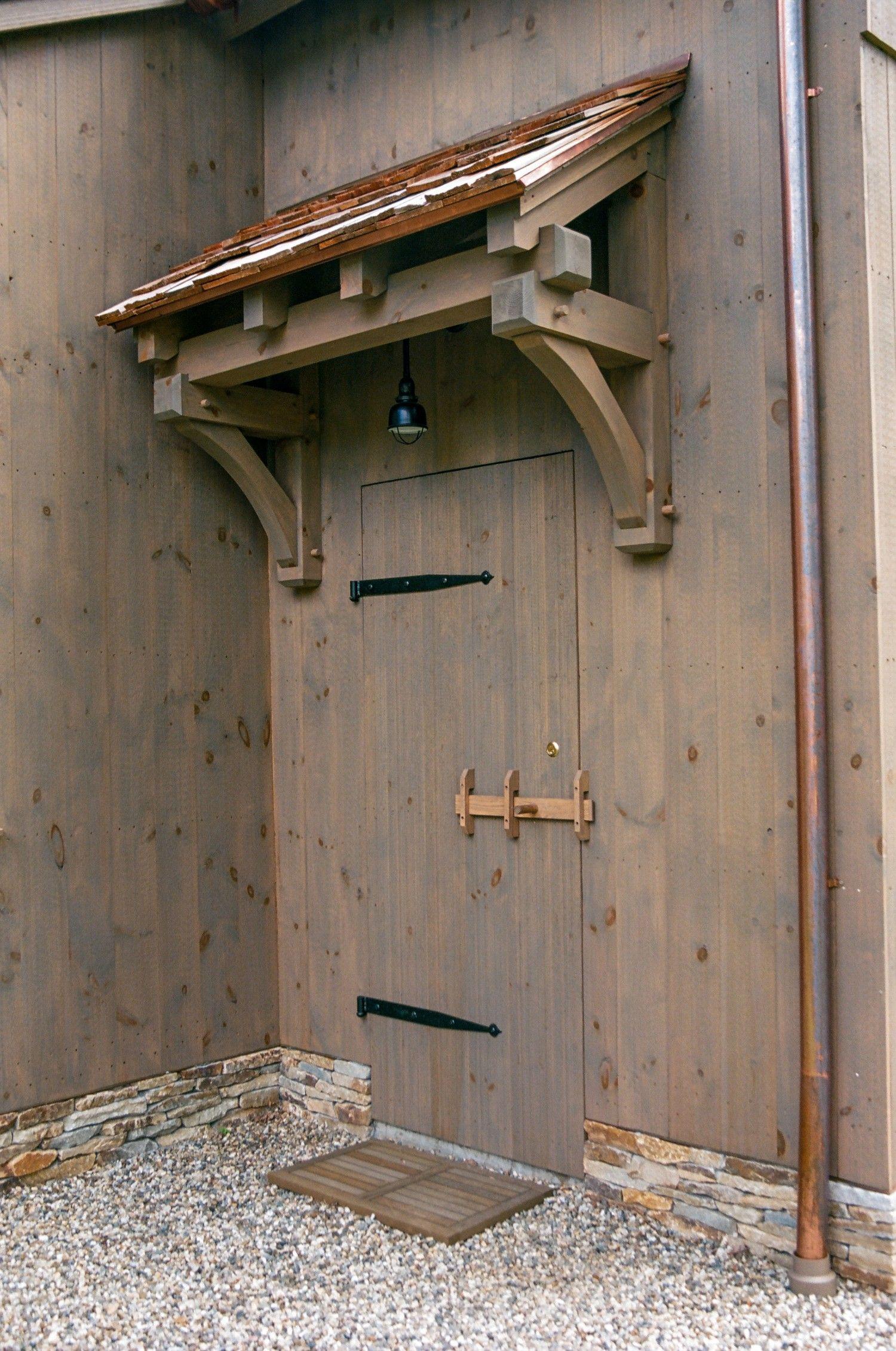 3' barn door with timber frame eyebrow roof   Timber framing