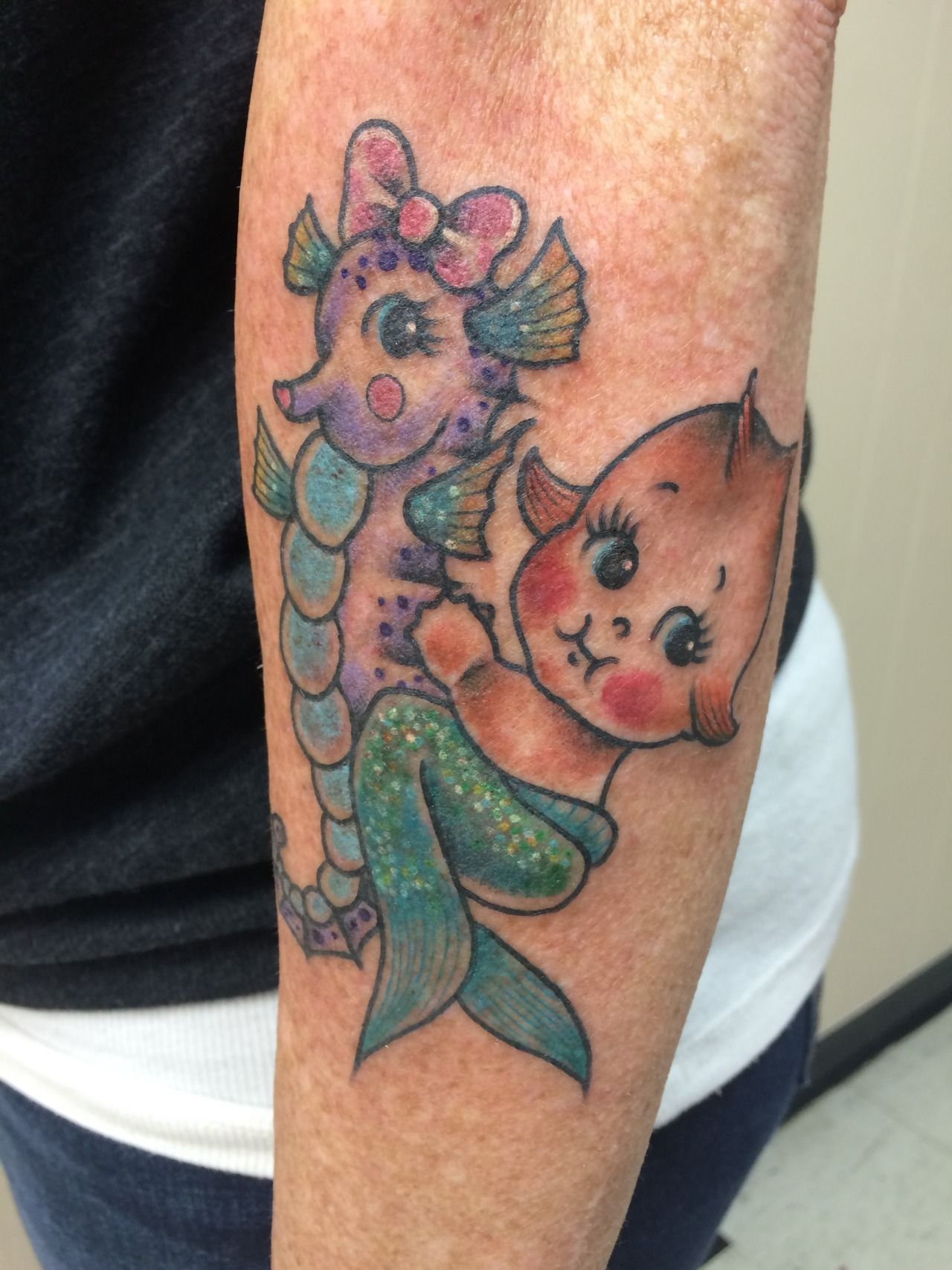 Little Mermaid Kewpie Riding A Seahorse By Candice At Autumn Moon Tattoo In Anaheim Ca Ig Candeeo Goldenbough Tumblr Com Doll Tattoo Tattoo Themes Tattoos