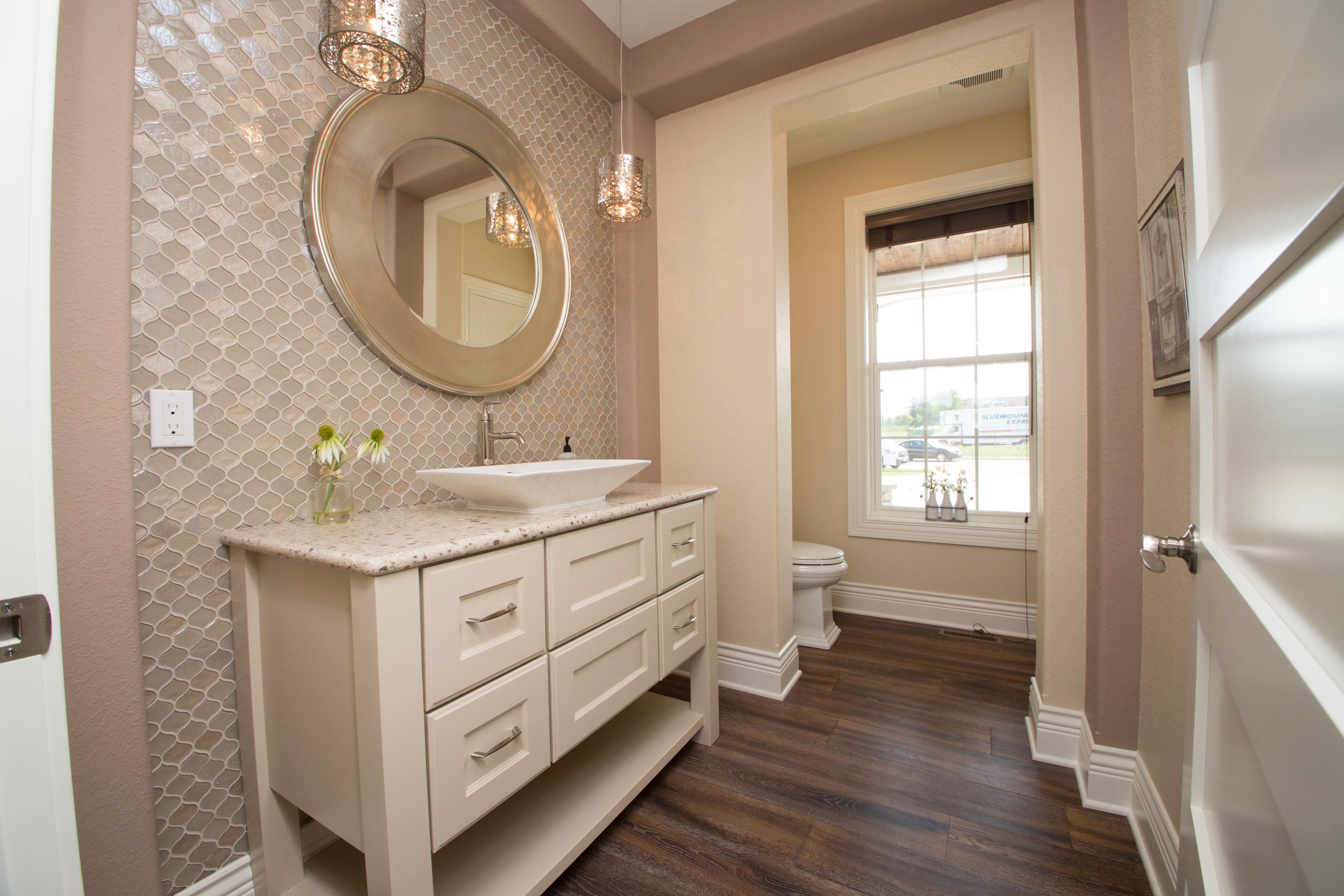 Place A Bathroom Vanity In Front Of A Full Wall Of Mosaic Tile For