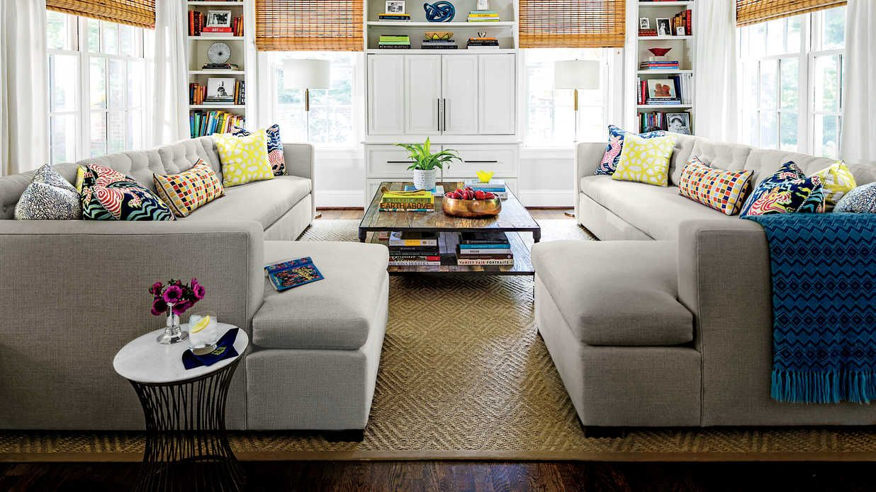 Forgo the Chairs - 108 Living Room Decorating Ideas - Southern Living - These oversize sectionals allow everyone to sit, without touching each other. The bench-style seat cushions look cleaner and don't shift around like multiple seat cushions do.