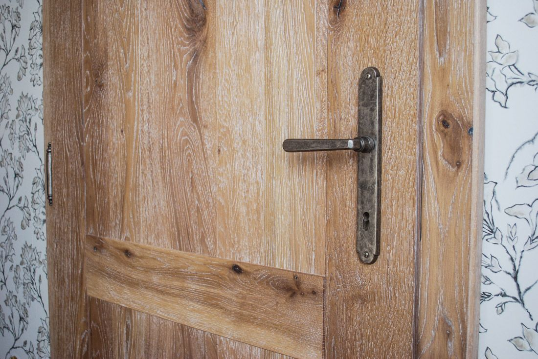 Beautiful brushed wooden door opens the view to a new …
