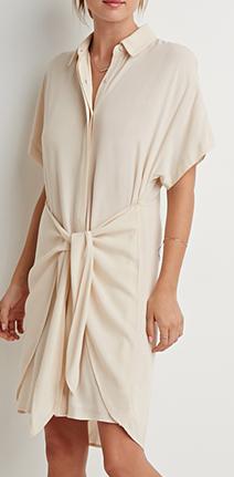 Vestido com gola normal, manga curta, no tecido Pucci de Milão e a amarração em couro preto.
