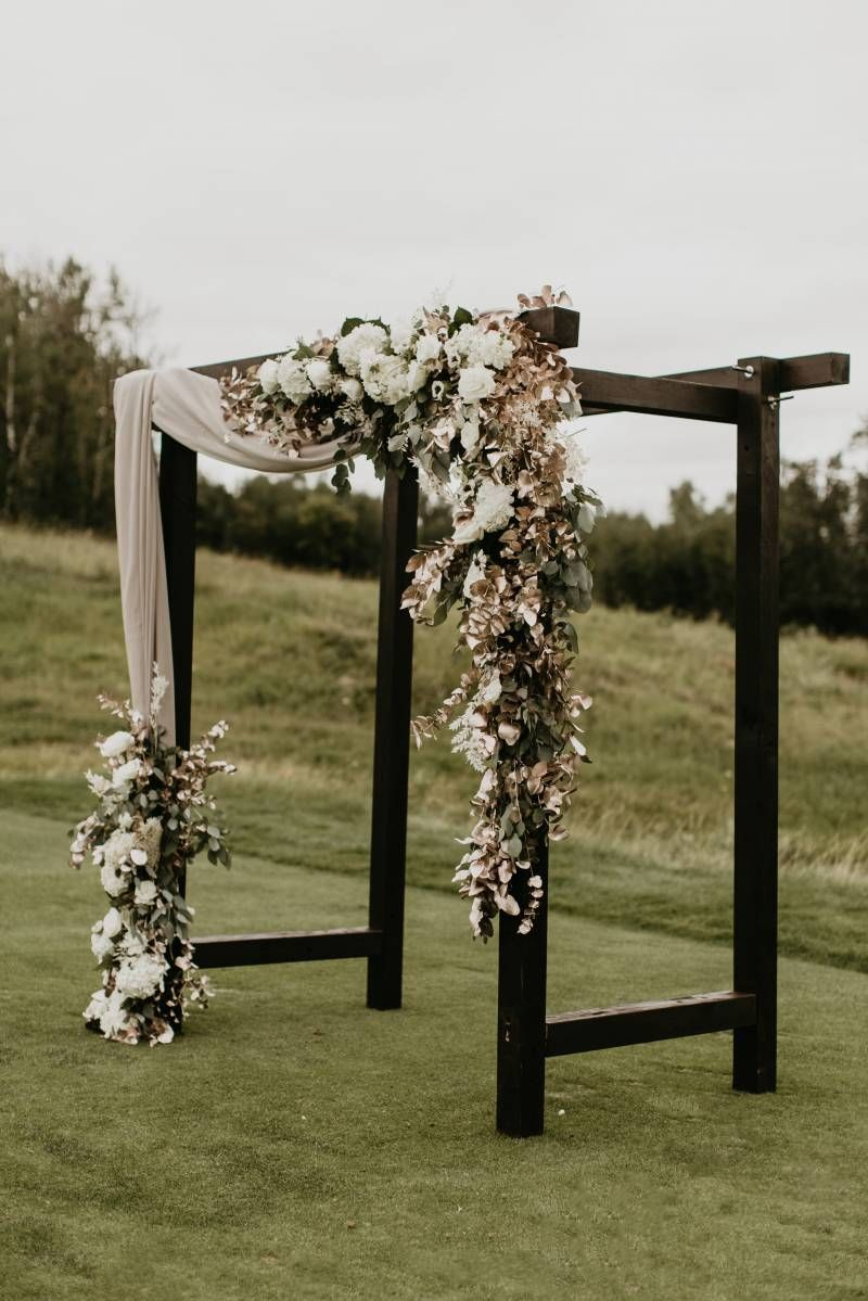 Black Ceremony Arch With Incredible Wedding Flowers In 2020 Wedding Arches Outdoors Wedding Arch Rustic Wedding Arch