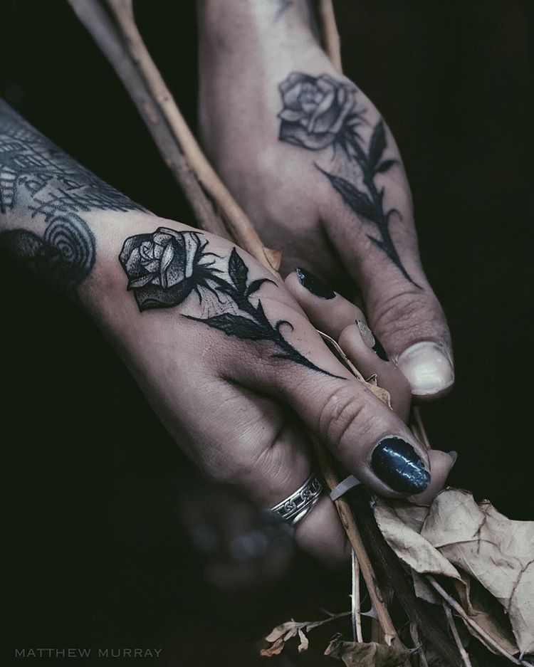 Black rose tattoos on both thumbs hand tattoos for guys