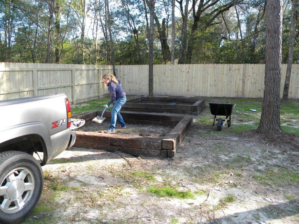 How to build raised vegetable beds with railroad ties - via oystersandpearls.net