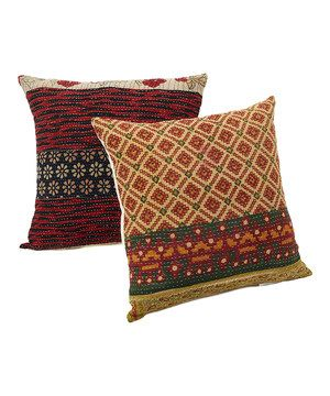 These bohemian pillows will adorn any couch with a charming design crafted from one-of-a-kind, hand-selected cotton quilts. The hand-stitched textiles are perfectly patched and carefully matched to create a timeless look. Note: This one-of-a-kind item is made from vintage fabric and may appear in colors or patterns other than shown.