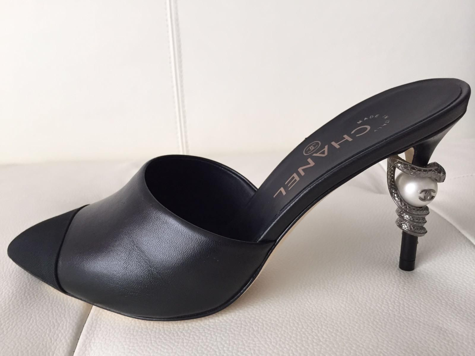 8ad44c78f02b Chanel Runway Leather Mules Heels Pearl Snake 37.5 Black Pumps. Get the  must-have pumps of this season! These Chanel Runway Leather…