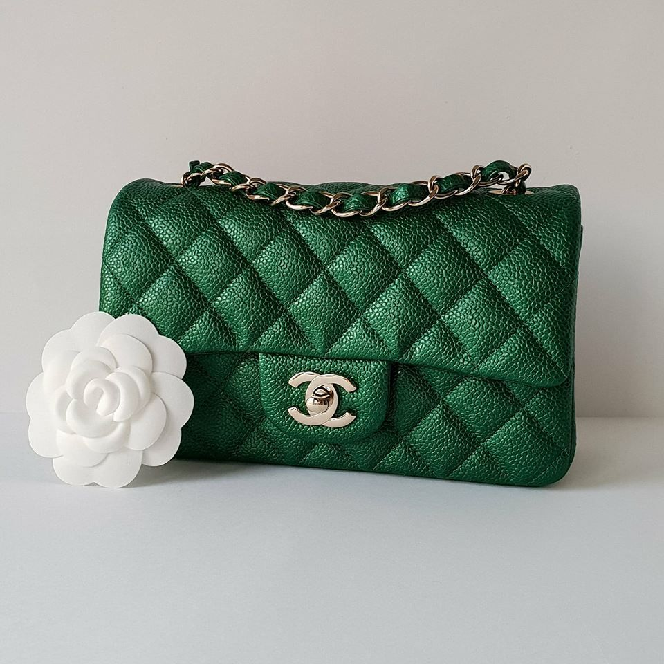 dc3396128998 Stunning emerald green Chanel Mini Rectangle in the durable caviar leather  with gold hardware.
