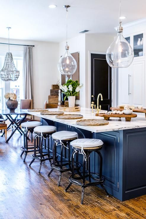 A Pair Of Bobo Intriguing Objects Wine Sphere Chandeliers Hangs Over Blue