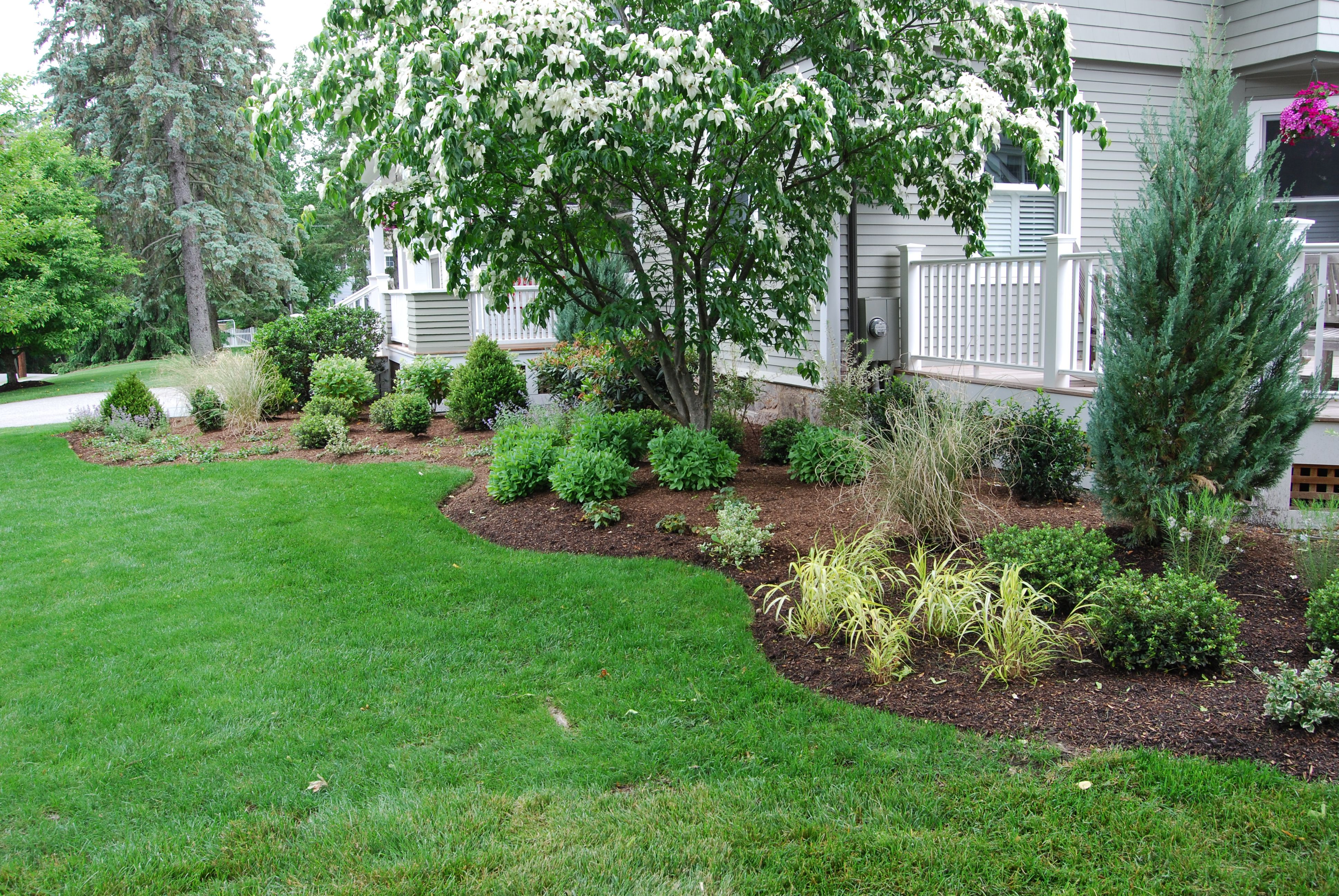 By Carey Ezell Landscape Design. Front plantings at large ...