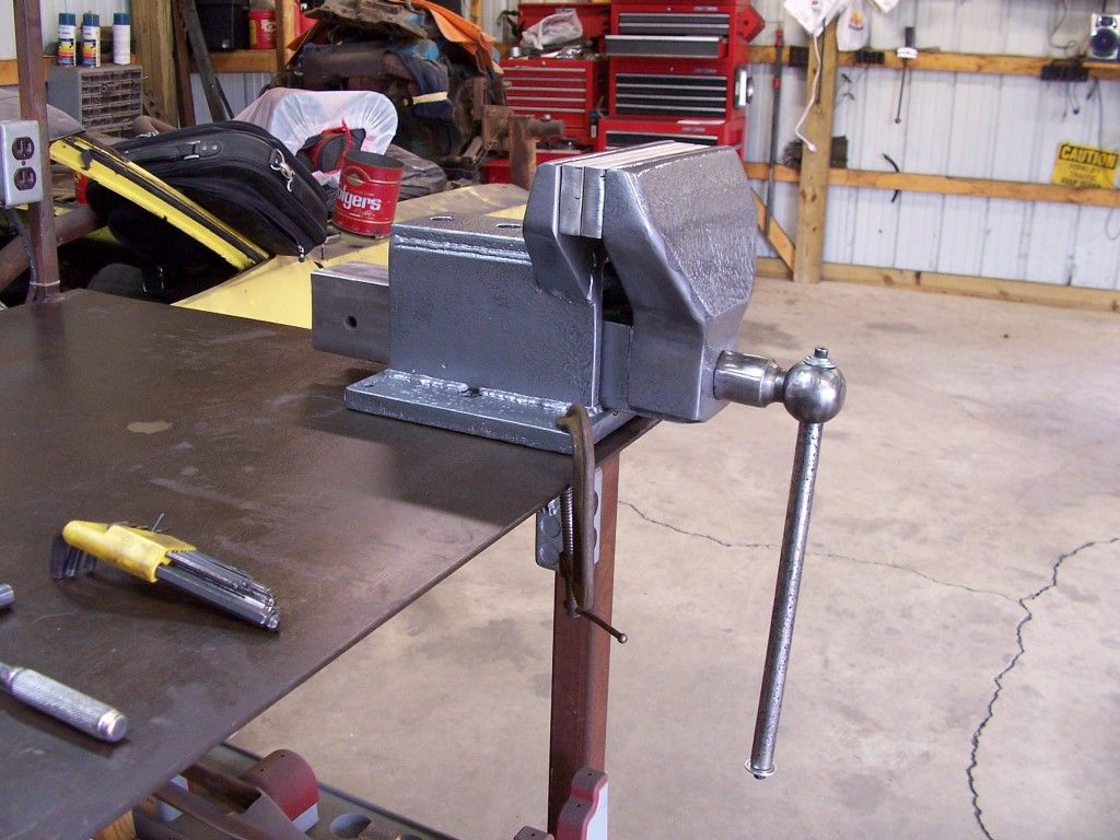 Home made vice. I like the use of a hitch ball for the