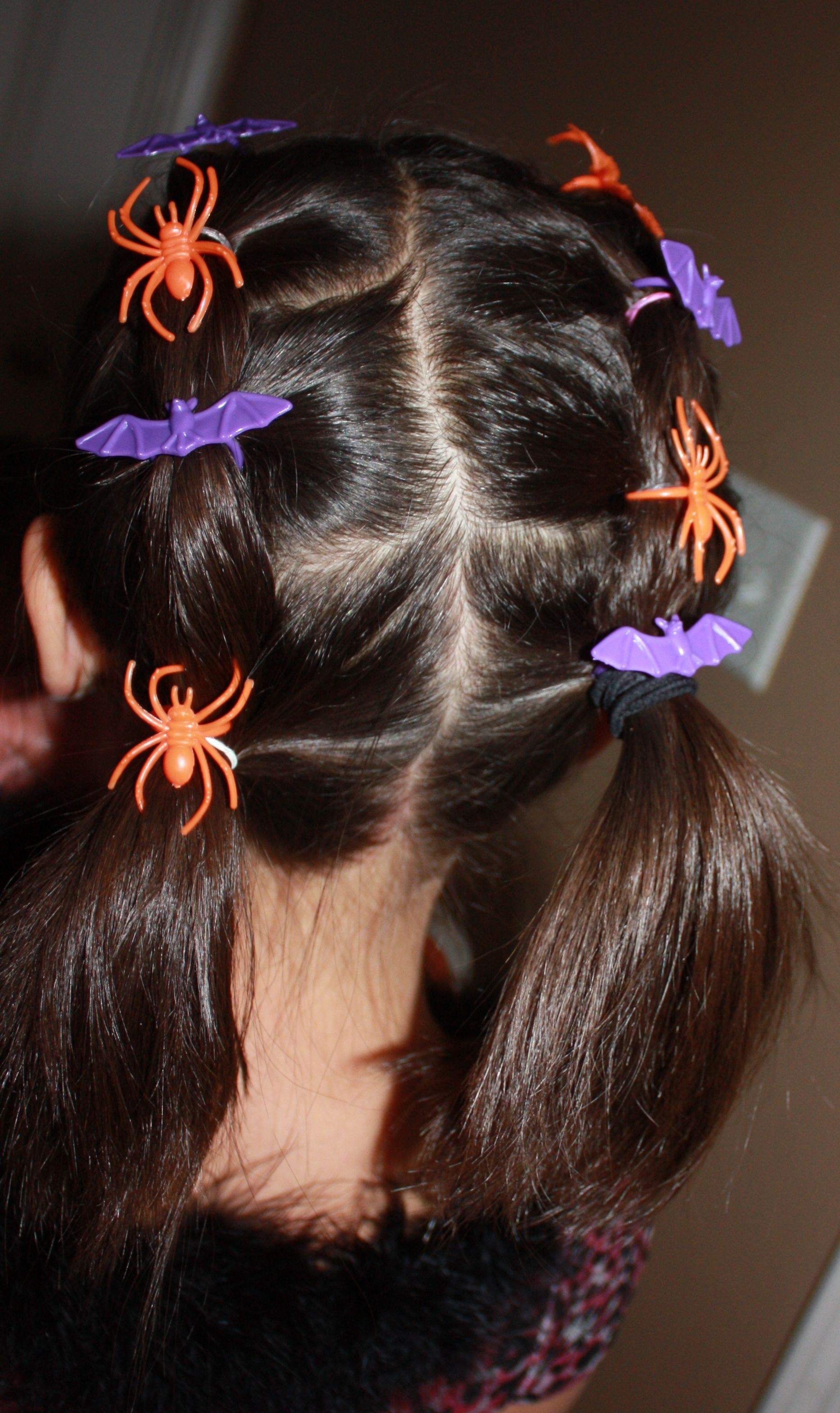 Halloween hairstyle for kids with halloween rings embellishments