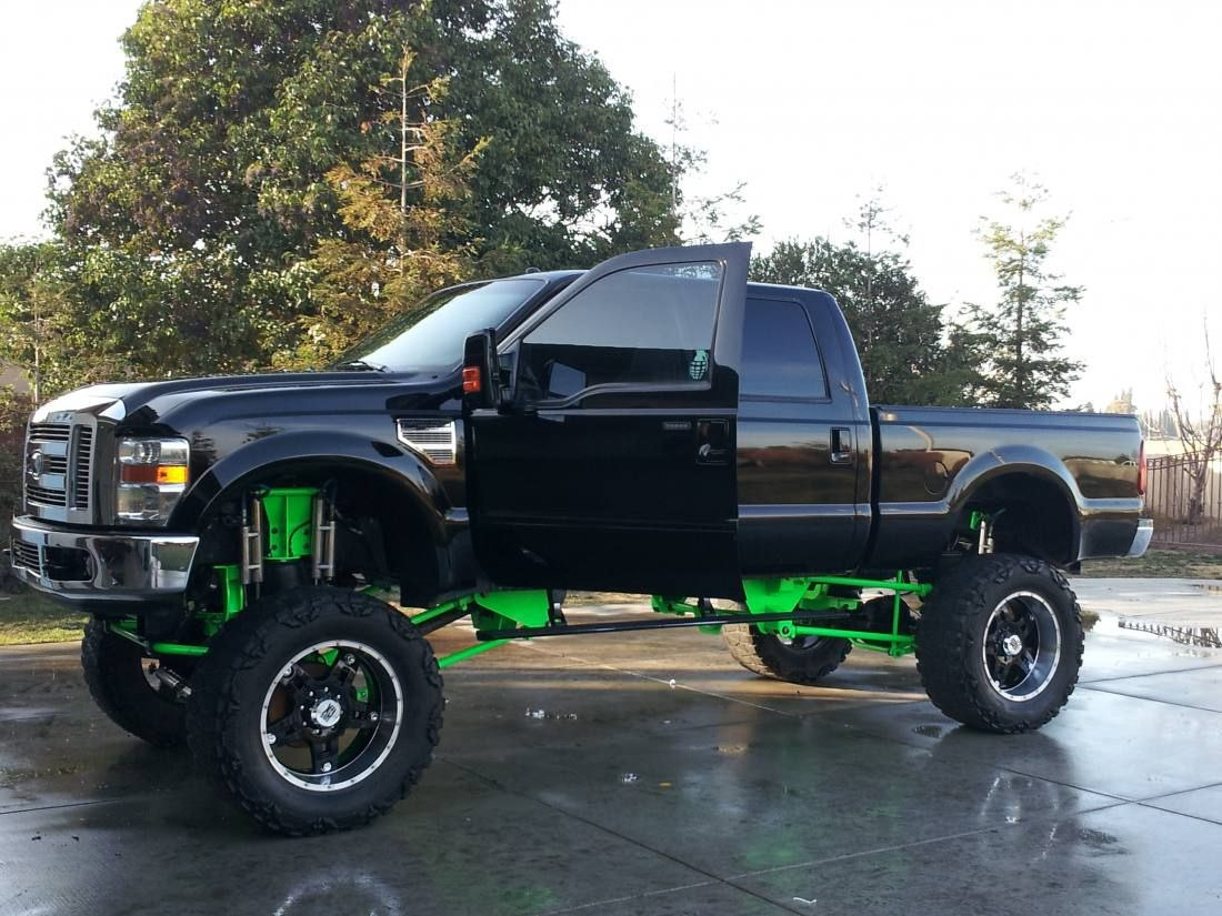 Hekka cool black and green ford truck with a hekka big lift so cool