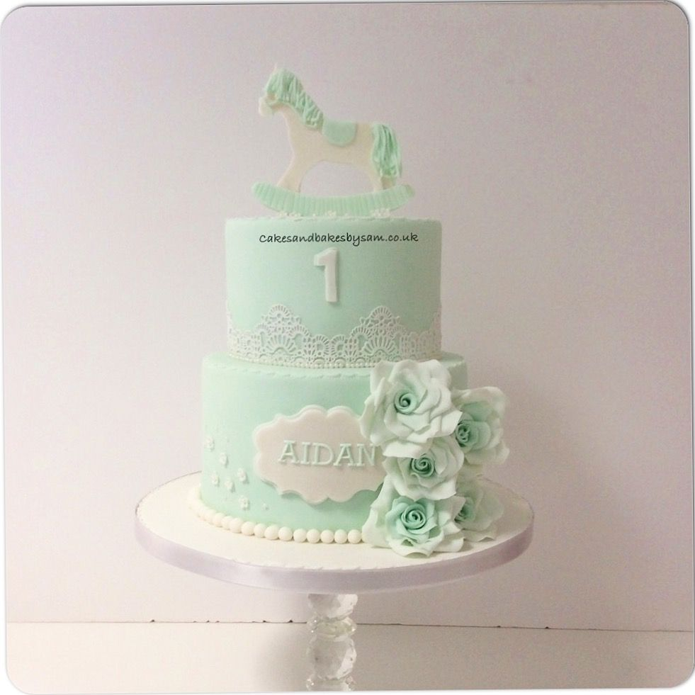 Mint green rocking horse and fondant sugar flower birthday cake