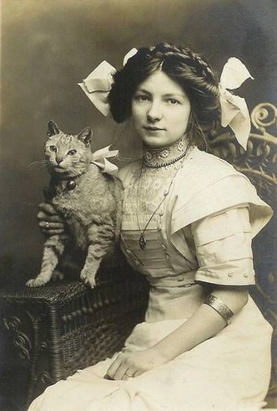 Woman in dress with cat (England c. 1900-1910)
